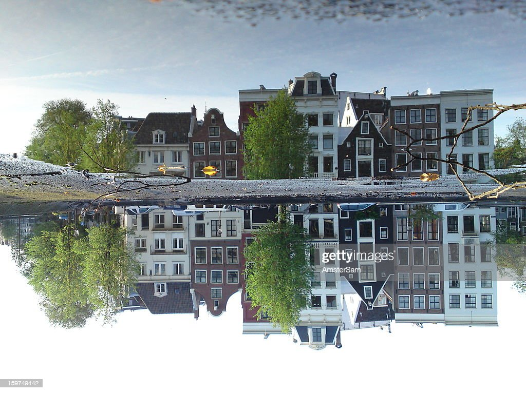 CONTENT] Unedited mobile phone cam photo of buildings reflected in a puddle on the roof of a house boat in Amsterdam. No editing, no tricks, no Photoshop.