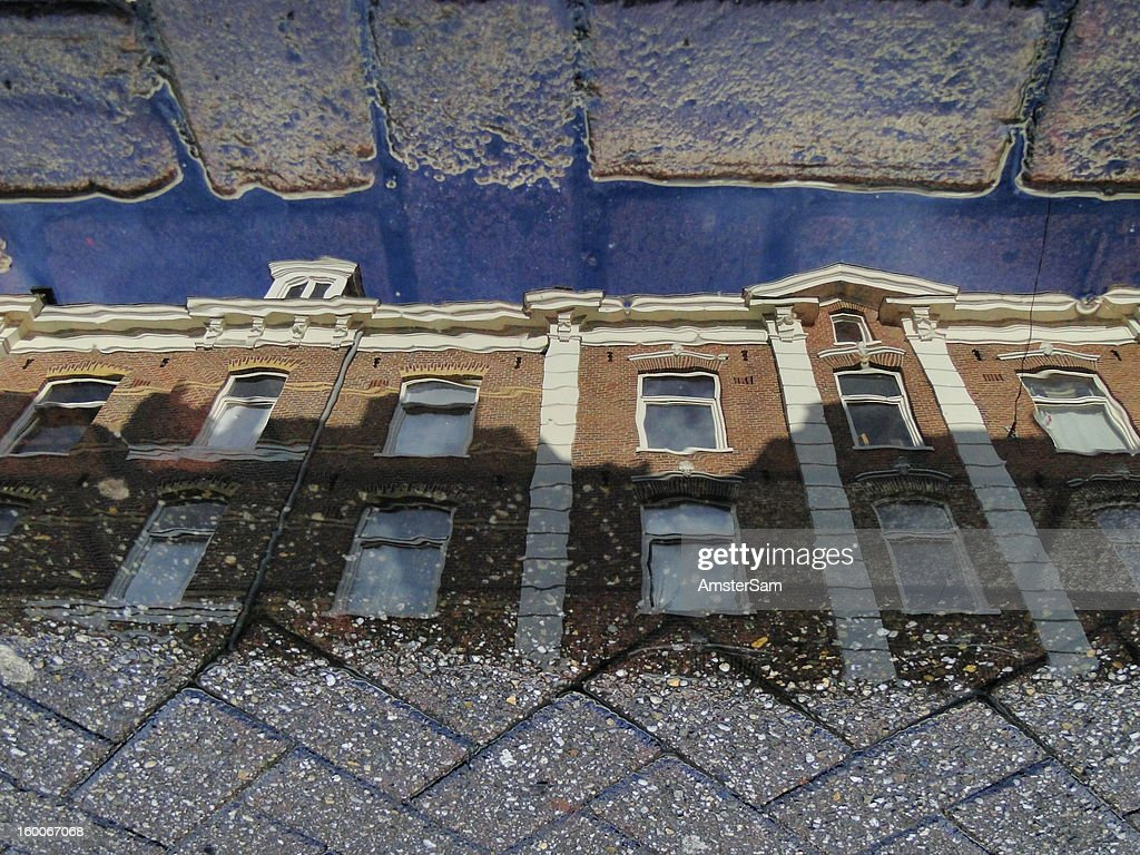 CONTENT] Unedited puddle reflection of a building in Amsterdam. Taken with my Sony HX1. No editing, no magic tricks, no Photoshop.