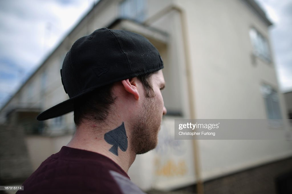 Unemployed Andrew Courtman wears a tattoo on his neck in Corby Town Centre on April 24, 2013 in Corby, England. A recent study pin pointed Corby as Britain's youth unemployment capital. The study by education specialists Ambitious Minds found that youth unemployment was 11% rising from 4% in 2007. Corby in Northamptonshire was built around its steel industry in the 1930's. The steel works closed in 1980 with the loss of 10,000 jobs.