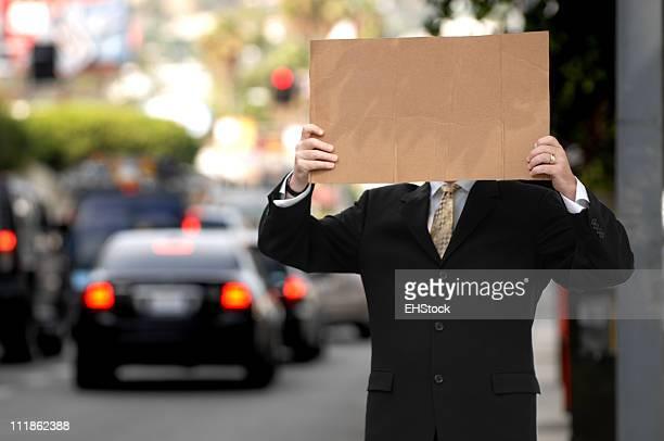 Unemployed Businessman on Street Corner with Blank Cardboard Sign