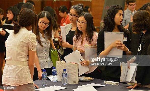 Unemployed Chinese graduates from British universities attend the LSE Beijing Career Fair as they search for jobs offered by foreign companies in...