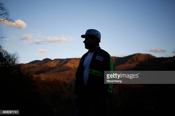 Unemployed coal miner Bobby Farley stands for a portrait in the front yard of his Harlan County home in Baxter Kentucky US on Thursday Nov 7 2013 In...
