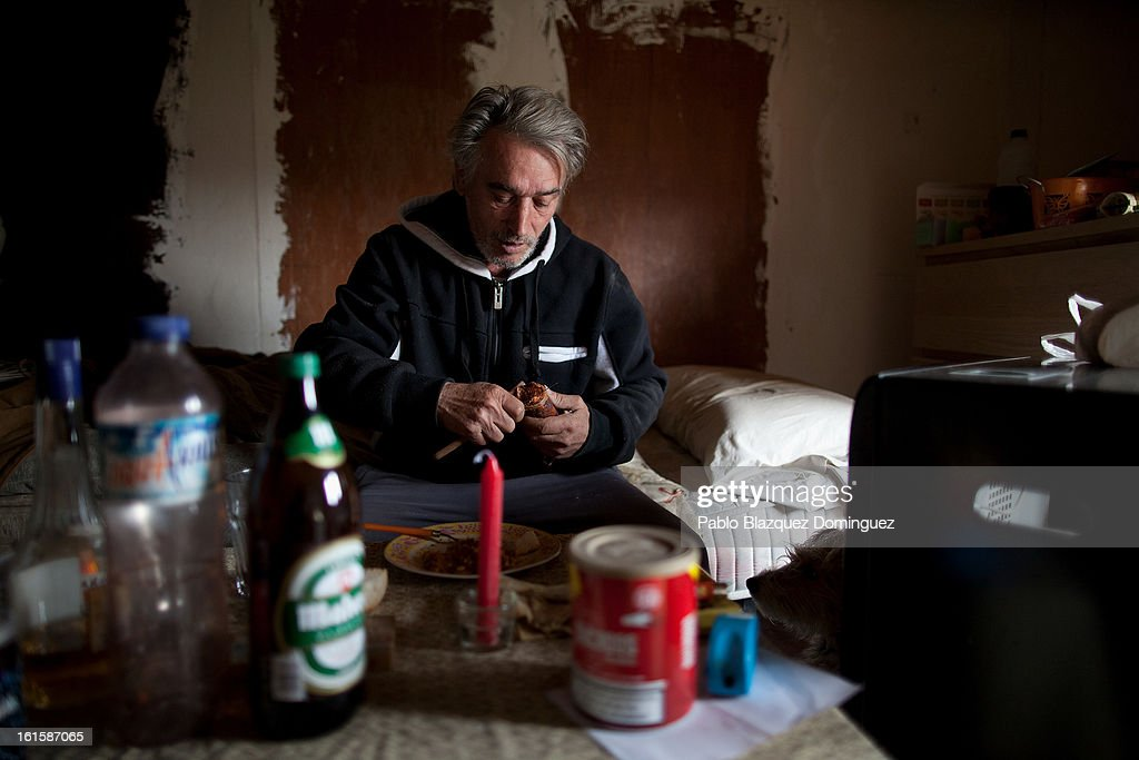 Unemployed Domingo Alcazar, 56, cuts a piece of 'chorizo' inside a hut on his allotment which is situated on the site for the proposed 'Eurovegas' complex on February 10, 2013 in Alcorcon, near Madrid, Spain. Domingo, who is unemployed after having worked previously in the construction industry, lives on the allotment because he cannot afford to pay standard accomdation rent fees. Controversial plans have been given the go ahead for the Las Vegas Sands Corporation to build Europe's biggest casino and conference centre on the outskirts of Madrid bringing thousands of much needed jobs for the Spanish economy. As multi billionaire investor Sheldon Adelson's announced his plans protestors were claiming that the 36,000 room hotel complex would bring gambling addiction, criminal activity, prostitution and environmental damage to the area.