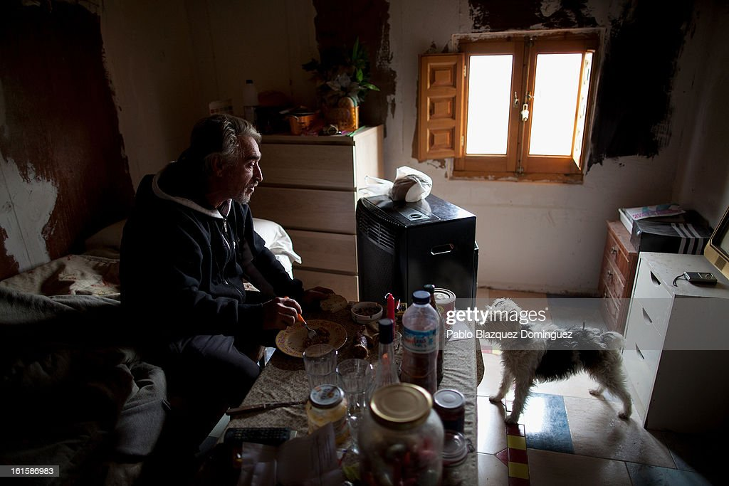 Unemployed Domingo Alcazar, 56, sits with his dog 'Boni' inside the hut on his allotment in which he lives and which is now situated on the site for the proposed 'Eurovegas' complex on February 10, 2013 in Alcorcon, near Madrid, Spain. Domingo, who is unemployed after having worked previously in the construction industry, lives on the allotment because he cannot afford to pay standard accomdation rent fees. Controversial plans have been given the go ahead for the Las Vegas Sands Corporation to build Europe's biggest casino and conference centre on the outskirts of Madrid bringing thousands of much needed jobs for the Spanish economy. As multi billionaire investor Sheldon Adelson's announced his plans protestors were claiming that the 36,000 room hotel complex would bring gambling addiction, criminal activity, prostitution and environmental damage to the area.