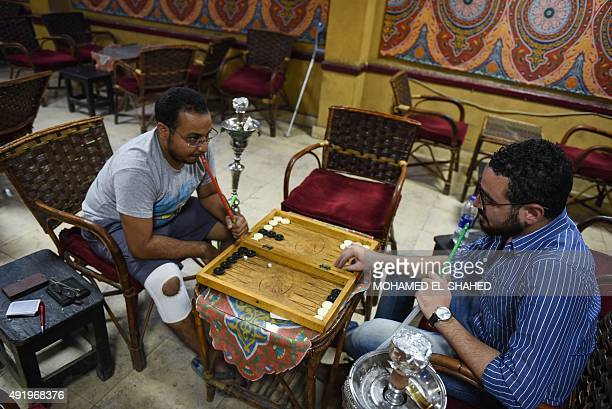 Unemployed Egyptian men play backgammon at a cafe in the capital Cairo on October 8 2015 North Africa and Middle East regions still have the highest...
