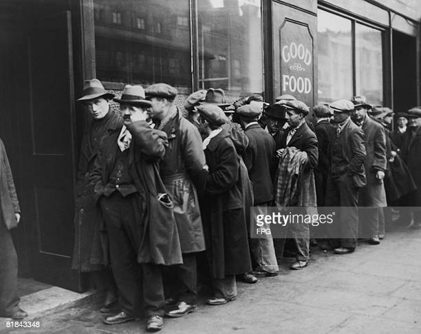 Unemployed men queuing outside a Salvation Army hostel circa 1935