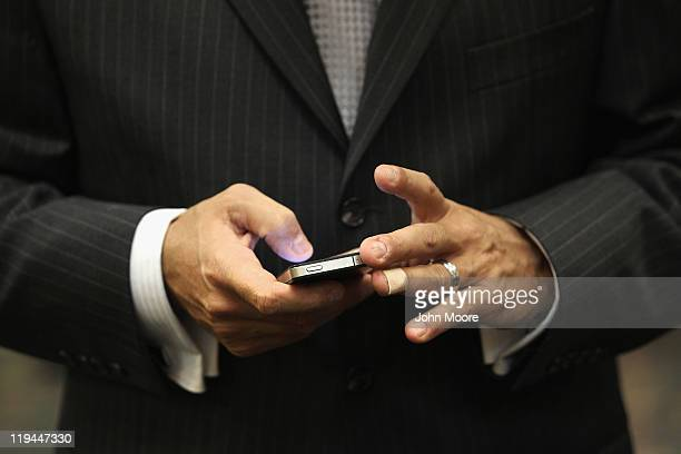 Unemployed sales manager Nick Fiacco arranges interviews on his smart phone while waiting to meet potential employers at a sales and management...