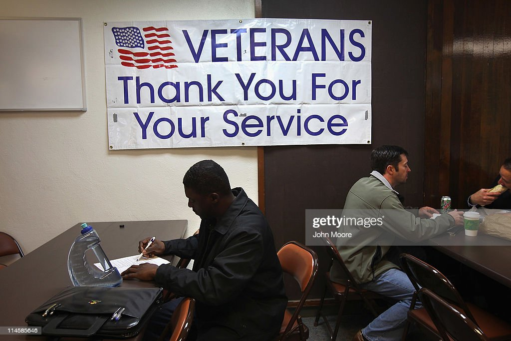 Unemployed US Air Force veteran Tracy McConner registers at the Military and Veterans Employment Expo on May 24 2011 in Golden Colorado The event was...