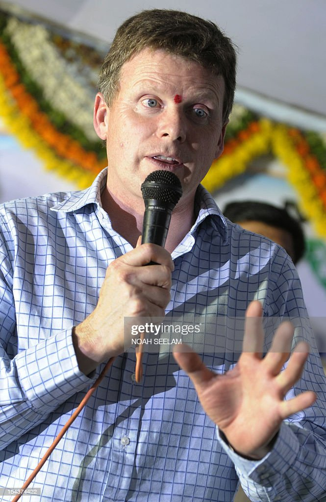 UN-environment-biodiversity-agriculture-India-cotton,FOCUS by Mariette le Roux British Environment Minister Richard Benyon gestures as he addresses an interaction with local political leaders and Indian cotton farmers in Warangal District, some 170kms north-east of Hyderabad on October 18, 2012. When Indian icon Mahatma Gandhi took up the baton for home-grown cotton a century ago, he may not have realised the devastating impact its cultivation would have on the land he so loved. Cotton is a thirsty plant and parts of India drought-prone. But the intensive farming process for cotton leaches the soil and requires high pesticide and fertiliser use that pollutes further downstream. AFP PHOTO/Noah SEELAM