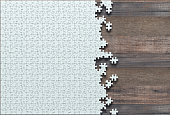 Blank jigsaw puzzle missing half to finish. Concept of work not completed.