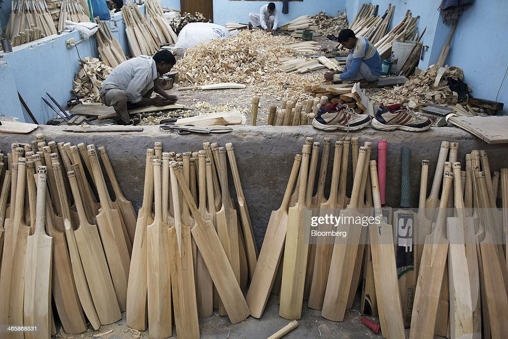 Unfinished cricket bats stand against a wall as employees use hand planes to shape cricket bats at a Stanford Cricket Industries factory in Meerut, Uttar Pradesh, India, on Wednesday, Jan. 29, 2014. The Indian Premier League (IPL), the worlds richest cricket competition, auction for IPL 2014 is scheduled to begin on Feb. 12 with the seasons first match to be played on April 8. Photographer: Prashanth Vishwanathan/Bloomberg via Getty Images