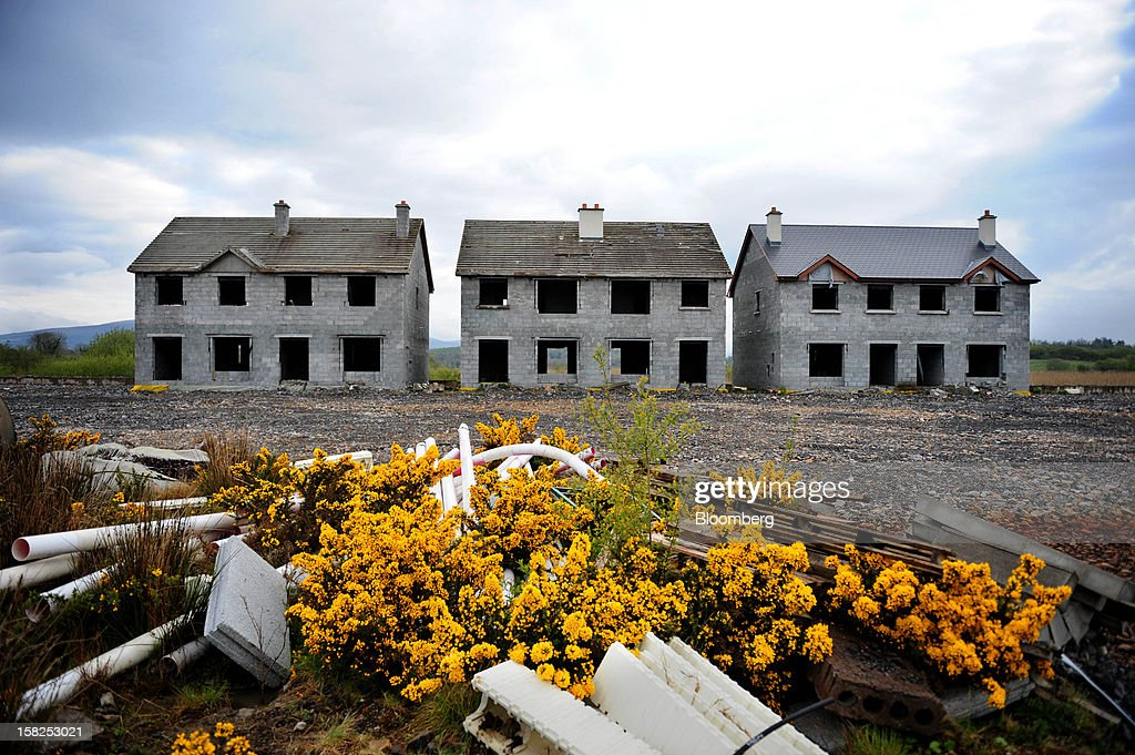Unfinished homes sit empty on an abandoned housing development in Keshcarrigan, Ireland, on Monday, April 23, 2012. Ireland's National Asset Management Agency is turning debtors into landlords as it seeks to recoup the 32 billion euros ($42 billion) it paid for commercial mortgages after the real-estate market collapsed. Photographer: Aidan Crawley/Bloomberg via Getty Images