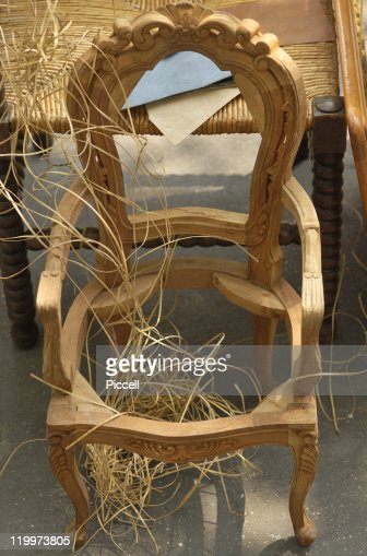 Unfinished little chair in front of big chair. : Stock Photo