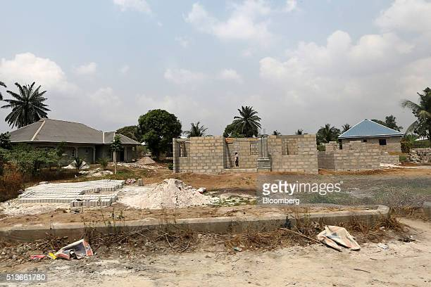 Unfinished new houses developed with compensation money paid to the local community by the Royal Dutch Shell Plc oil company as a result of the 2008...