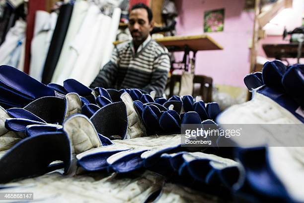 Unfinished wicketkeeper gloves sit stacked at a Stanford Cricket Industries factory in Meerut Uttar Pradesh India on Wednesday Jan 29 2014 The Indian...