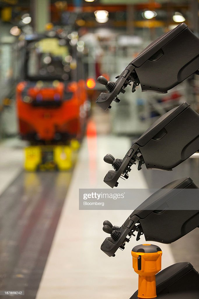 Unfitted hydraulic control levers sit beside the vehicle production line at the Linde Material Handling GmbH factory, a unit of Kion Group AG, in Aschaffenburg, Germany, on Tuesday, Nov. 12, 2013. Kion Group AG, the German forklift-maker which listed shares in June, is looking to expand its global sales network via acquisitions to catch up with main competitor Toyota Industries Corp. Photographer: Krisztian Bocsi/Bloomberg via Getty Images