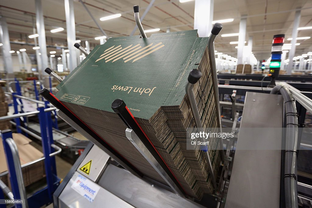 Unfolded lids of boxes are stacked in a hopper of an automated packing machine in the distribution centre where the company's partners process the online orders for the John Lewis department store on January 3, 2013 in Milton Keynes, England. John Lewis has published their sales report for the five weeks prior December 29, 2012 which showed online sales had increased by 44.3 per cent over the same period in 2011. Purchases from their website Johnlewis.com now account for one quarter of all John Lewis business.