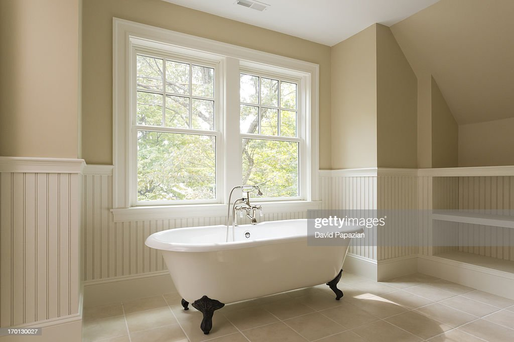 unfurnished bathroom with clawfoot tub stock photo getty images. Black Bedroom Furniture Sets. Home Design Ideas
