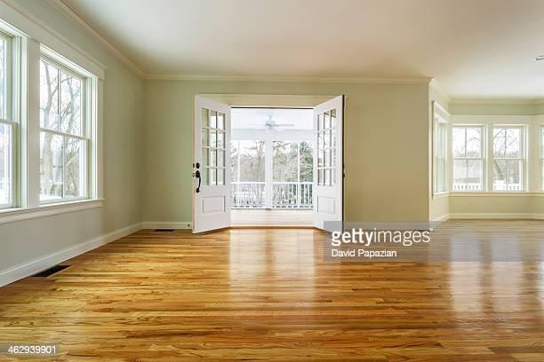 Unfurnished family room with hardwood floors
