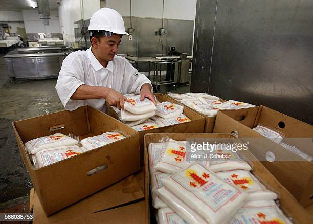 Ung Thong assembles an order of rice noodles stored at room temperature for a restraurant customer at the Lucky KT Noodle factory in El Monte...