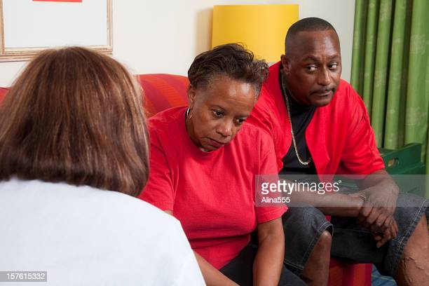 Unhappy african-american couple at the marriage counselor