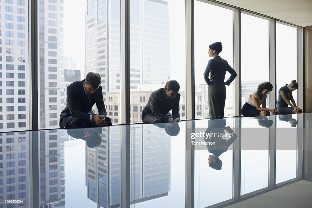 Unhappy business people sitting in conference room : Stock Photo