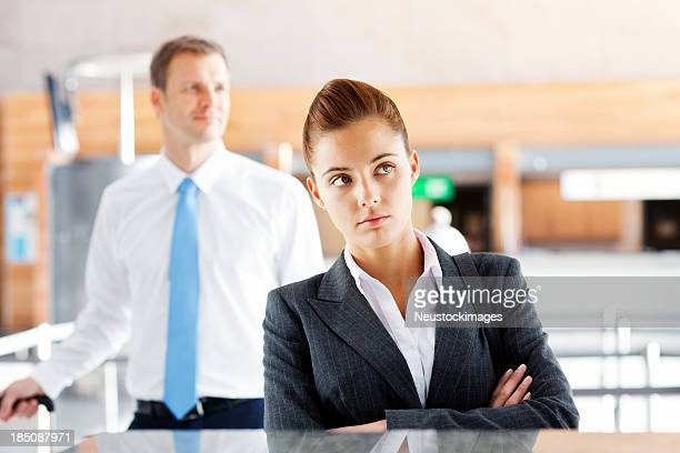 Unhappy Business Woman Waiting At Check-In Desk