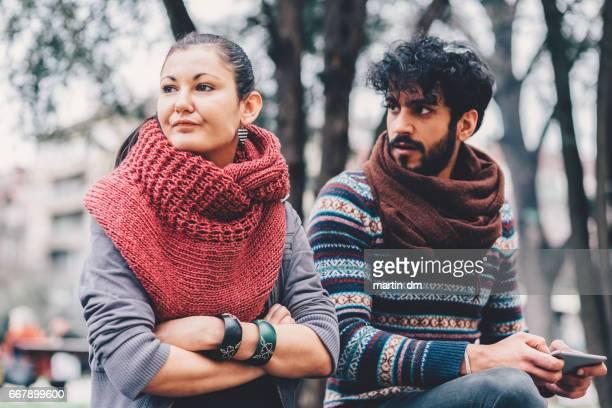Unhappy couple outside