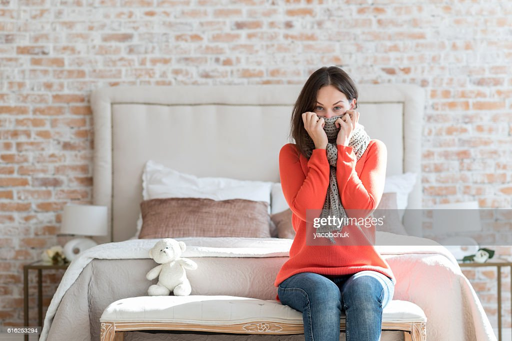 Unhappy ill woman wearing a scarf : Foto de stock