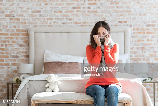 Unhappy ill woman wearing a scarf : Stock Photo