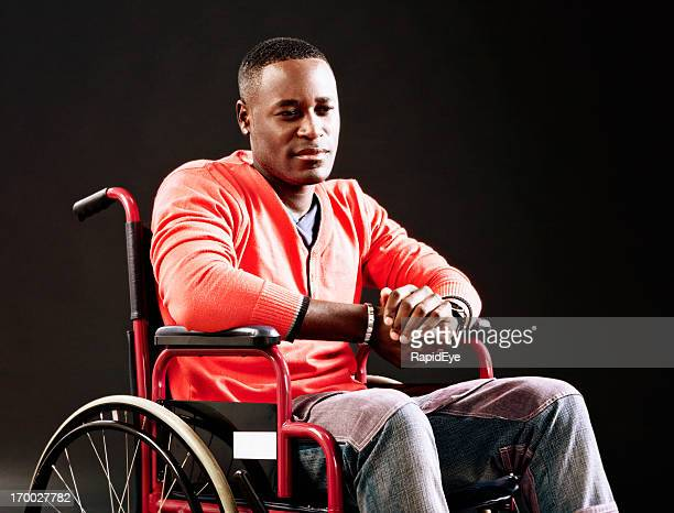 Unhappy man in wheelchair, possibly an injured athlete