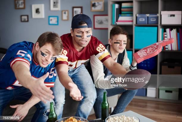 Unhappy men while watching American football. Debica, Poland