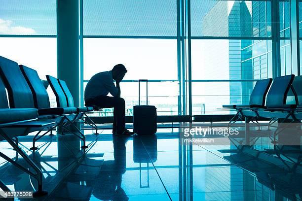Unhappy passenger waits for flight at airport