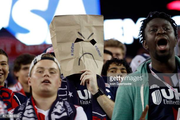 Unhappy Rev fan takes his anger out on New England Revolution head coach Jay Heaps during a regular season MLS match between the New England...