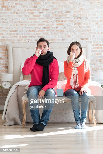 Unhappy sad couple suffering from flu : Foto de stock