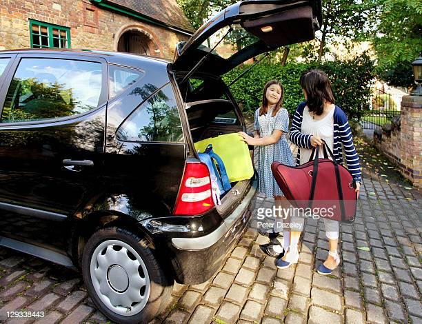 Unhappy school girl going back to school