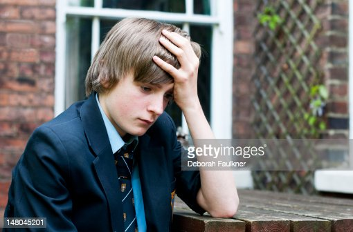 Unhappy teenage school boy