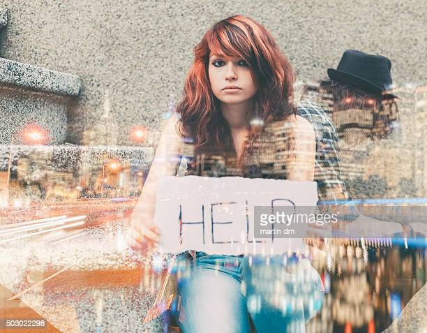 Unhappy teenager showing a paper with help wanted sign