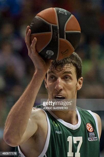 Unicaja's centre Fran Vazquez holds up the ball during the Euroleague basketball match Unicaja vs Olympiacos on January 2 2015 at the Palacio de los...