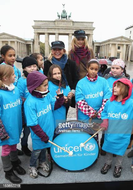 Unicef ambassadors Sabine Christiansen and Eva Padberg pose with children during the Unicef girls day photocall near the Brandenburg Gate on October...