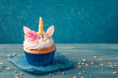 Unicorn cupcake on a wooden background