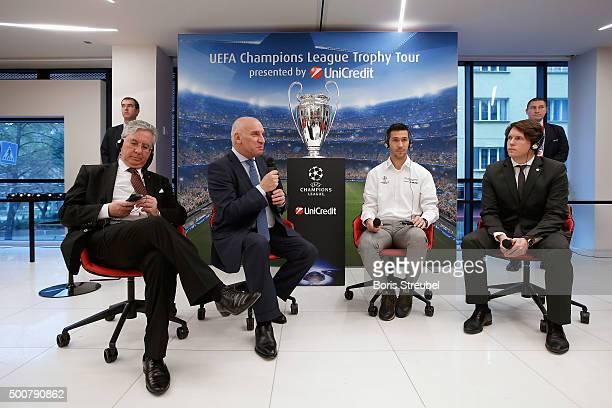 UniCredit general manager Andrea Casini UniCredit CEO Levon Hampartzoumian UEFA ambassador Luis Garcia and Lars Ellensohn of UEFA attend a press...
