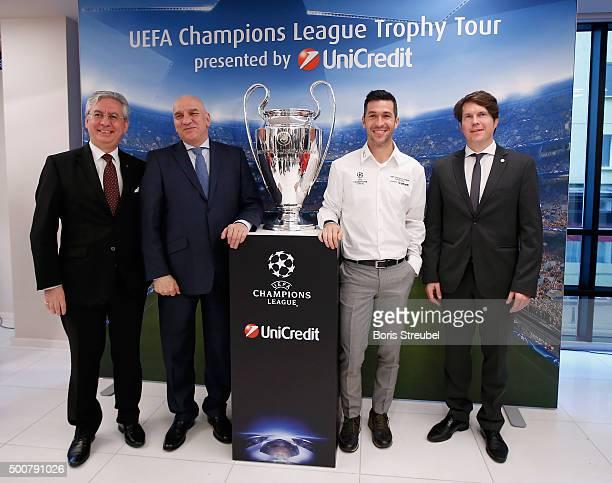 UniCredit general manager Andrea Casini UniCredit CEO Levon Hampartzoumian UEFA ambassador Luis Garcia and Lars Ellensohn of UEFA pose with the...