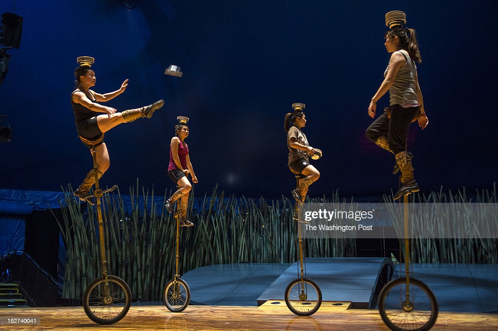 Unicyclists from Inner Mongolia from left, Hao Yuting,17, He Xuedi, 17, Wen Xin,16, and Zhang Jie, 24, rehearse their act of kicking bowls that they catch and balance on each others heads Wednesday September 19, 2012 at National Harbor, MD. The three minors along with Wu Yurong,17, not pictured, attend school while on the tour with Cirque du Soleil when they are not performing or rehearsing.