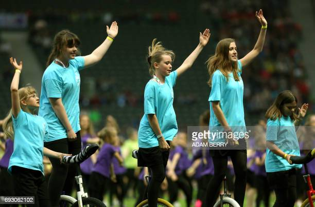 Unicyclists perform at the Stadium Gala of the 2017 Deutsches Turnfest at the Olympic Stadium in Berlin on June 6 2017 / AFP PHOTO / Adam BERRY