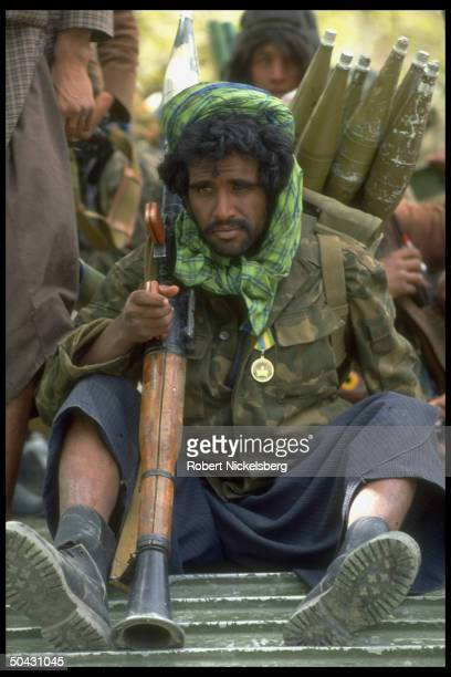 Unident combatants resting re postNajibullah internecine war engaging forces of interim govtallied Dostam's Uzbek militia Hekmatyar mujahedin