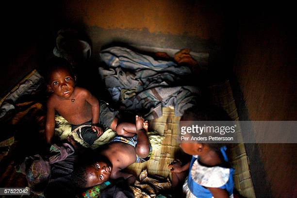 Unidentified Aids orphans wake up in a hut on November 16 2005 in Galufu Malawi The village has about 378 orphans out of a population of about 1400...