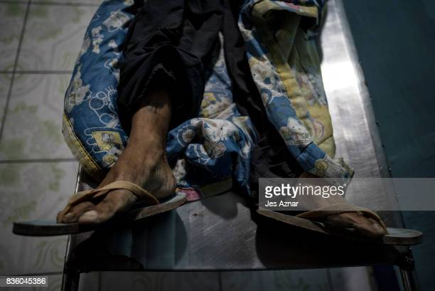 Unidentified bodies lay inside a funeral morgue after being shot by police in an alleged antidrug operation on August 17 2017 in Navotas Philippines...