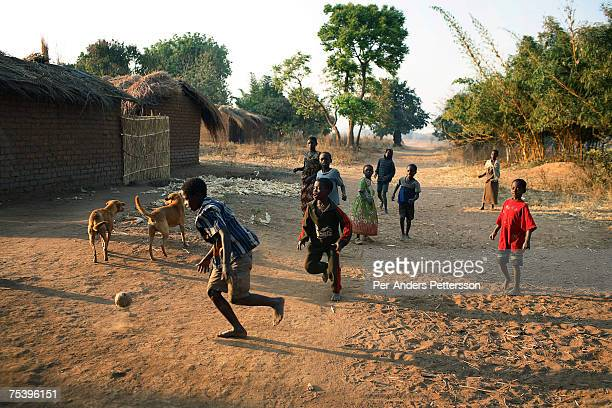 Unidentified boys play soccer on August 18 2006 in Mphandula village about 30 miles outside Lilongwe Malawi Mphandula is a poor village in Malawi...