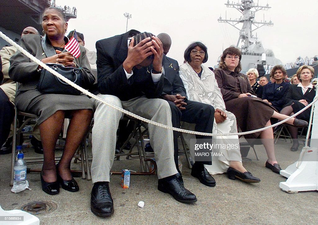 Unidentified family members of victims of the deadly explosion to the USS Cole attend a memorial service 18 October, 2000 at Norfolk Naval Base in Norfolk, Virginia. At right is First Lady Hillary Rodham Clinton. The apparent terrorist attack in Yemen left 17 American sailors presumed dead and 39 injured. US President Bill Clinton, Defense Secretary William Cohen, Joint Chiefs Chairman Hugh Shelton and Attorney General Janet Reno were in attendance. AFP PHOTO/Mario TAMA